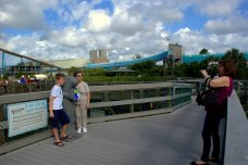 Visitors take a picture with a manatee statue at the Manatee Viewing Center at Apollo Beach. Photo/Kendra Yost